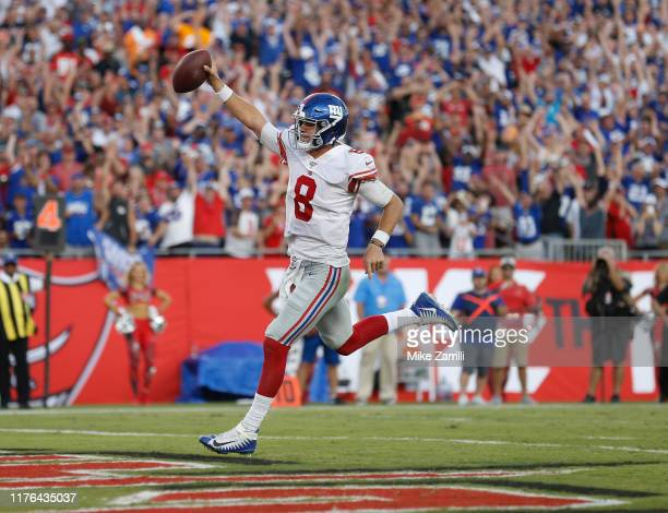 Quarterback Daniel Jones of the New York Giants runs in for the game winning touchdown in the fourth quarter during the game against the Tampa Bay...