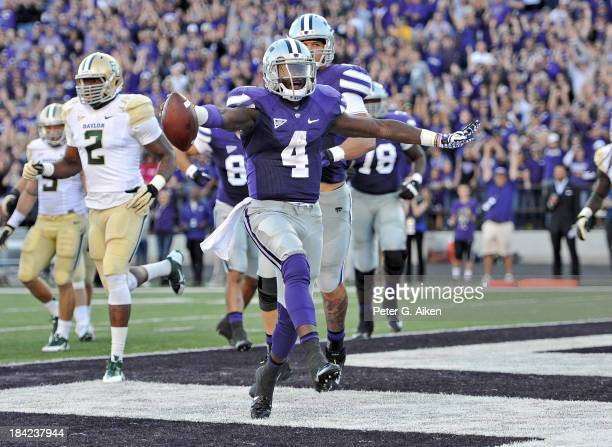 Quarterback Daniel Sams of the Kansas State Wildcats celebrates after scoring a touchdown against the Baylor Bears during the second half on October...