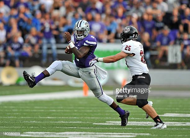 Quarterback Daniel Sams of the Kansas State Wildcats rushes past safety Joey Colton of the Massachusetts Minutemen during the first half on September...