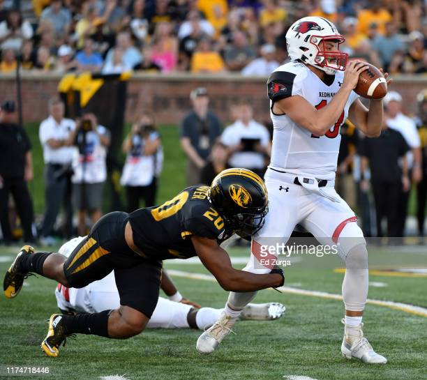 Quarterback Daniel Santacaterina of the Southeast Missouri State Redhawks is sacked by defensive back Khalil Oliver of the Missouri Tigers during the...