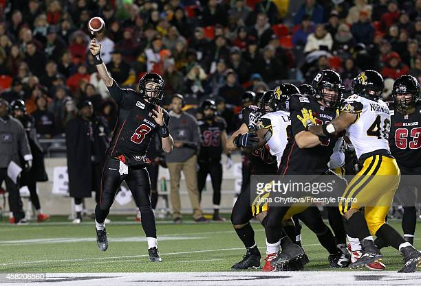 Quarterback Danny O'Brien of the Ottawa Redblacks throws the ball in the second quarter during a CFL game against the Hamilton TigerCats at TD Place...