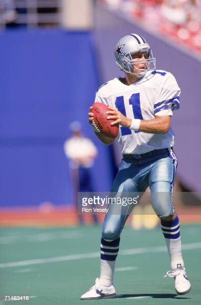 Quarterback Danny White of the Dallas Cowboys drops back to pass during a September 1987 game