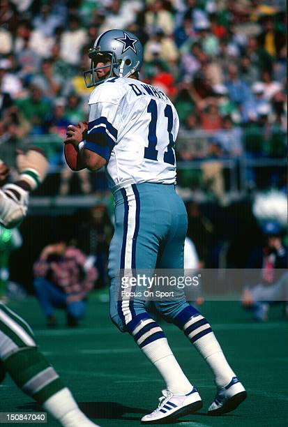 Quarterback Danny White of the Dallas Cowboys drops back to pass against the Philadelphia Eagles during an NFL football game at Veterans Stadium...