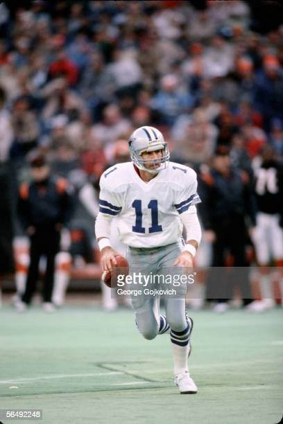 Quarterback Danny White of the Dallas Cowboys in action against the Cincinnati Bengals at Riverfront Stadium on December 8 1985 in Cincinnati Ohio