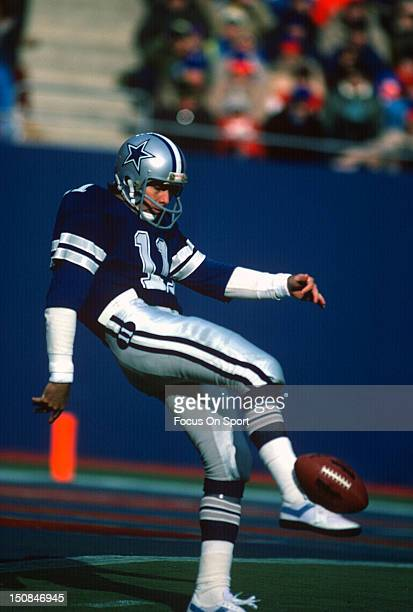 Quarterback Danny White of the Dallas Cowboys punts the ball against the New York Giants during an NFL football game at Giant Stadium December 19...