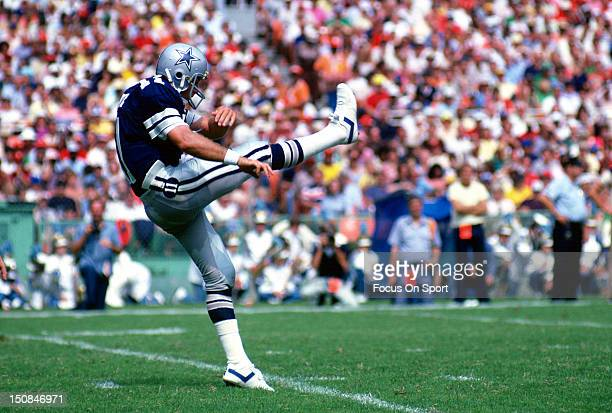 Quarterback Danny White of the Dallas Cowboys punts the ball against the Washington Redskins during an NFL football game at RFK Stadium September 6...