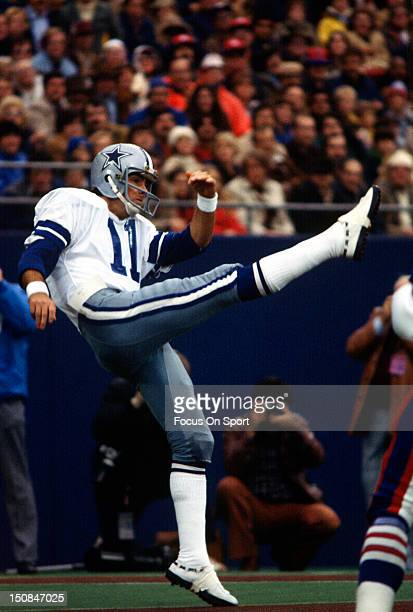 Quarterback Danny White of the Dallas Cowboys punts the ball against the New York Giants during an NFL football game at Giant Stadium circa 1980 in...