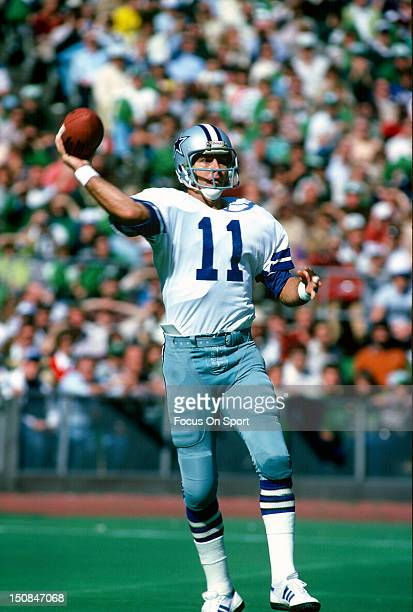 Quarterback Danny White of the Dallas Cowboys throws a pass against the Philadelphia Eagles during an NFL football game at Veterans Stadium circa...