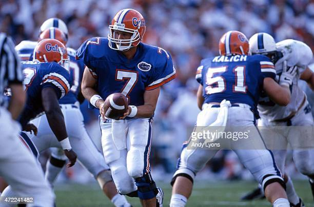 Quarterback Danny Wuerffel of the Florida Gators looks to hand off the ball during an NCAA game against the Kentucky Wildcats on September 28 1996 at...