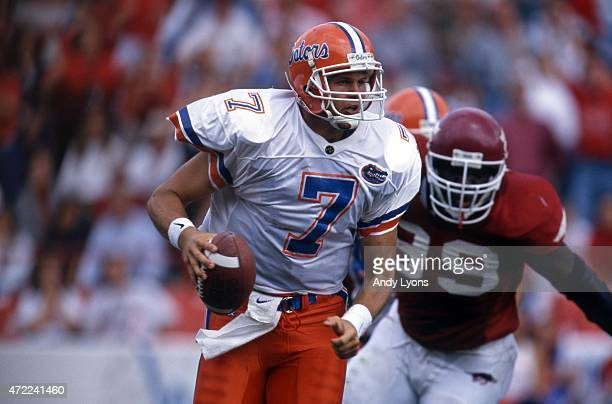 Quarterback Danny Wuerffel of the Florida Gators runs with the ball during an NCAA game against the Arkansas Razorbacks on October 5, 1996 at...
