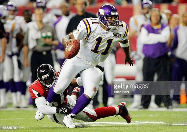 Quarterback Dante Culpepper of the Minnesota Vikings gets sacked after stumbling against defensive end Demorrio Williams of the Atlanta Falcons in...