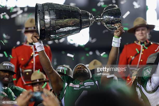 Quarterback Darian Durant of the Saskatchewan Roughriders hoists the Grey Cup following their 4523 victory over the Hamilton TigerCats during the...