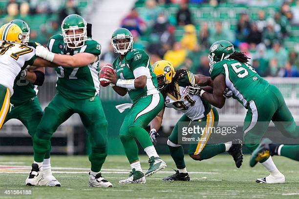 Quarterback Darian Durant of the Saskatchewan Roughriders looks down field for a receiver during a preseason game between the Edmonton Eskimos and...
