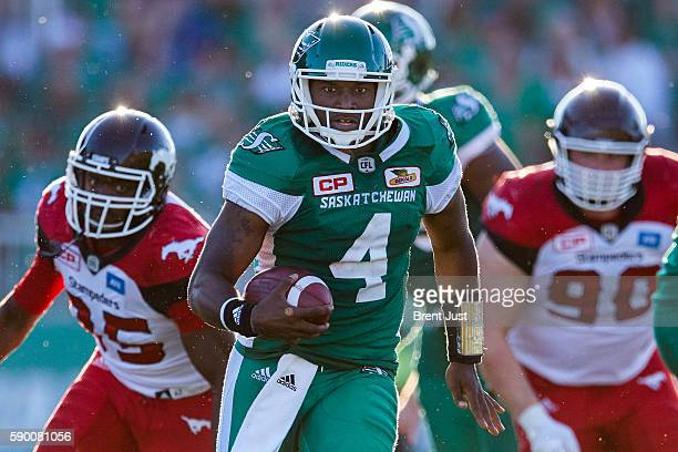 Quarterback Darian Durant of the Saskatchewan Roughriders scrambles out of the pocket in the game between the Calgary Stampeders and Saskatchewan...