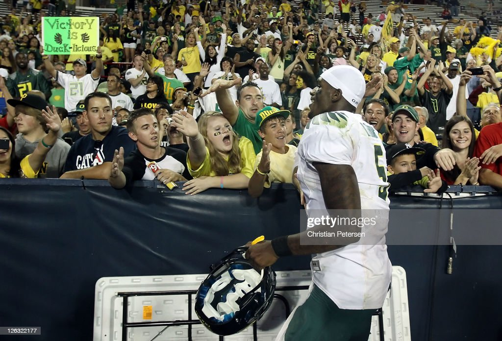 Quarterback Darron Thomas #5 of the Oregon Ducks celebrates with fans after defeating the Arizona Wildcats in the college football game at Arizona Stadium on September 24, 2011 in Tucson, Arizona. The Ducks defeated the Wildcats 56-31.