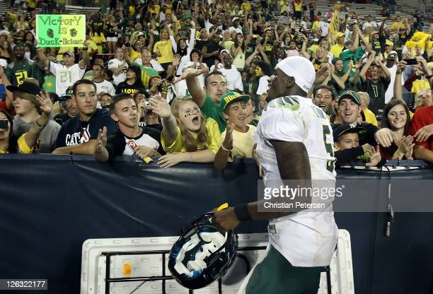 Quarterback Darron Thomas of the Oregon Ducks celebrates with fans after defeating the Arizona Wildcats in the college football game at Arizona...