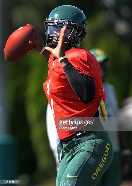 Quarterback Darron Thomas of the Oregon Ducks throws the ball during practice on August 17 2010 in Eugene Oregon