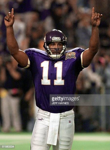 Quarterback Daunte Culpepper of the Minnesota Vikings celebrates after a touchdown against the New Orleans Saints 06 January 2001 during the second...