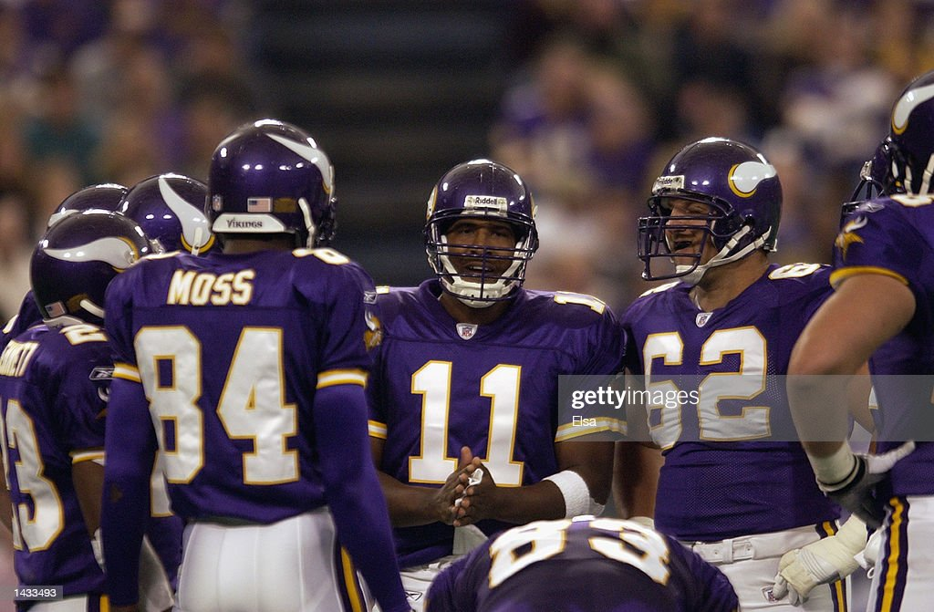 Quarterback Daunte Culpepper #11 of the Minnesota Vikings gives the play to the offense in the huddle against the Carolina Panthers during the game on September 22, 2002 at the Hubert H. Humphrey Metrodome in Minneapolis, Minnesota. The Panthers defeated the Vikings 21-14.