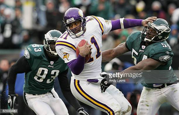 Quarterback Daunte Culpepper of the Minnesota Vikings is chased by linebacker Jeremiah Trotter and defensive end Jevon Kearse of the Philadelphia...