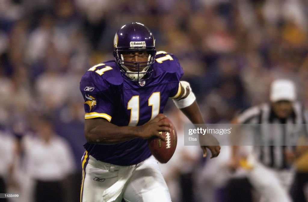 Quarterback Daunte Culpepper #11 of the Minnesota Vikings runs with the ball against the Carolina Panthers during the game on September 22, 2002 at the Hubert H. Humphrey Metrodome in Minneapolis, Minnesota. The Panthers defeated the Vikings 21-14.