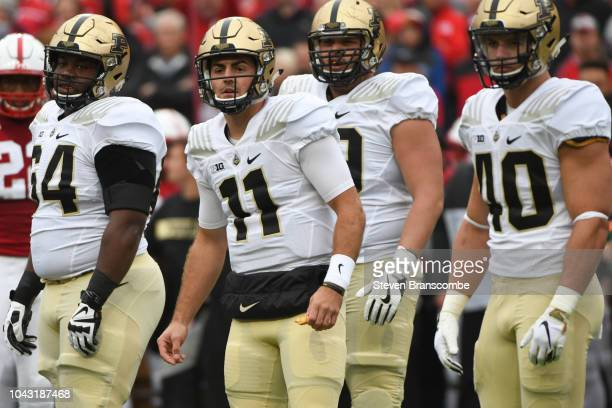 Quarterback David Blough of the Purdue Boilermakers and teammates look for a call from the bench in the game against the Nebraska Cornhuskers at...