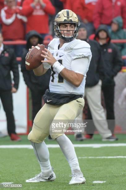 Quarterback David Blough of the Purdue Boilermakers drops back to pass against the Nebraska Cornhuskers at Memorial Stadium on September 29 2018 in...