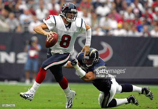 Quarterback David Carr of the Houston Texans breaks away from the attempted tackle of Ben Leber of the San Diego Chargers on September 12, 2004 at...