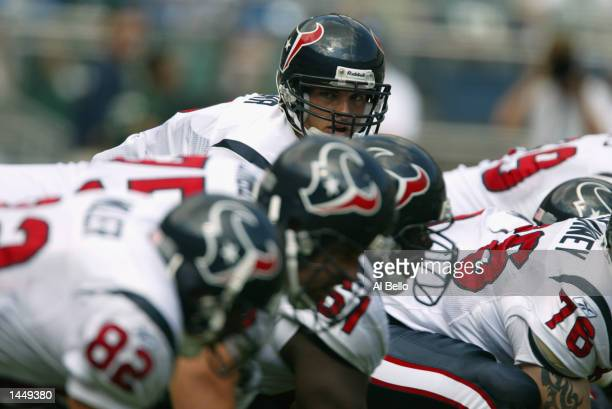 Quarterback David Carr of the Houston Texans peers over his line against the Philadelphia Eagles during the game on September 29 2002 at Veterens...