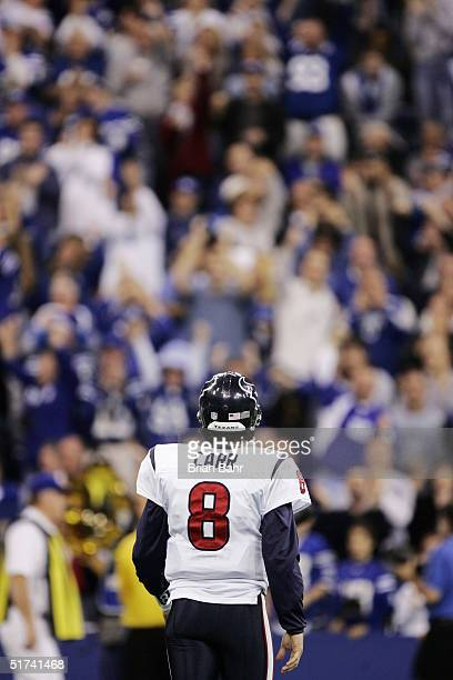 Quarterback David Carr of the Houston Texans walks back to the bench after throwing an interception to linebacker Gary Brackett of the Indianapolis...