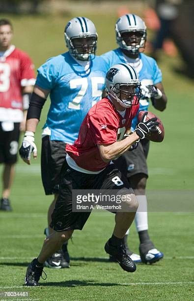 Quarterback David Carr scrambles for some yardage during day three of mini-camp at the Carolina Panthers practice facility in Charlotte, NC, Sunday,...