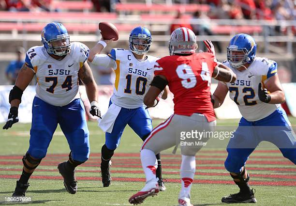 Quarterback David Fales of the San Jose State Spartans has protection from Ryan Jones and Wes Schweitzer as he throws over Jeremiah Valoaga of the...