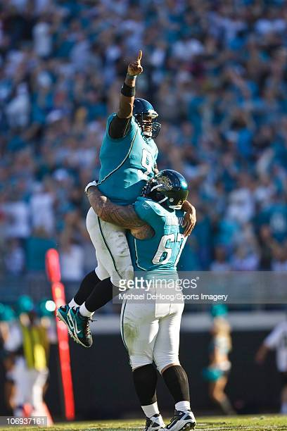 Quarterback David Garrard celebrates with guard Vince Manuwai of the Jacksonville Jaguars after winning touchdown against the Houston Texans November...