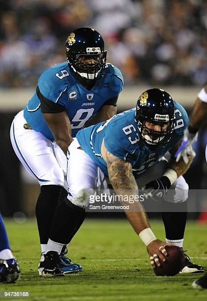 Quarterback David Garrard of the Jacksonville Jaguars calls out signals as he gets set for the snap from center Brad Meester in the first half...