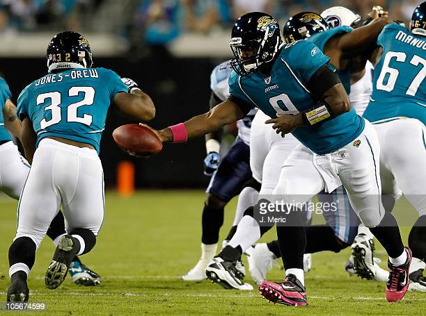 Quarterback David Garrard of the Jacksonville Jaguars hands the ball off to running back Maurice JonesDrew against the Tennessee Titans during the...
