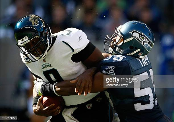 Quarterback David Garrard of the Jacksonville Jaguars ids sacked by Darryl Tapp of the Seattle Seahawks at Qwest Field on October 11 2009 in Seattle...