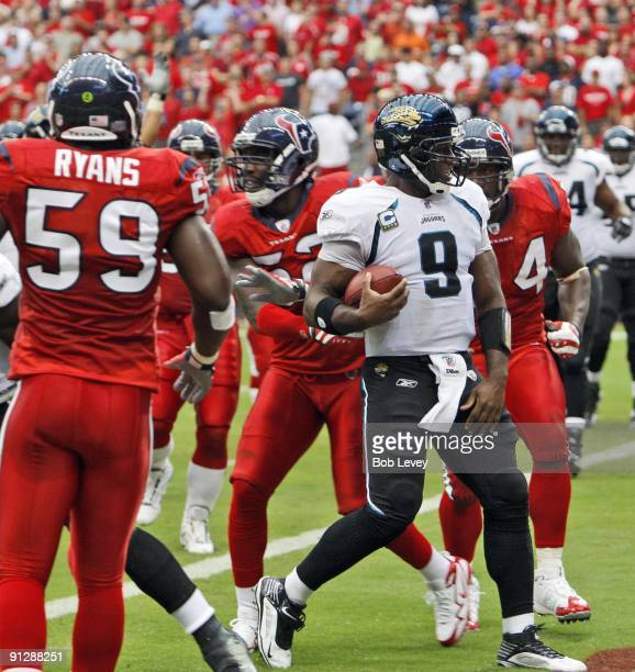 Quarterback David Garrard of the Jacksonville Jaguars scores on a keeper in the first quarter during the game against the Houston Texans at Reliant...