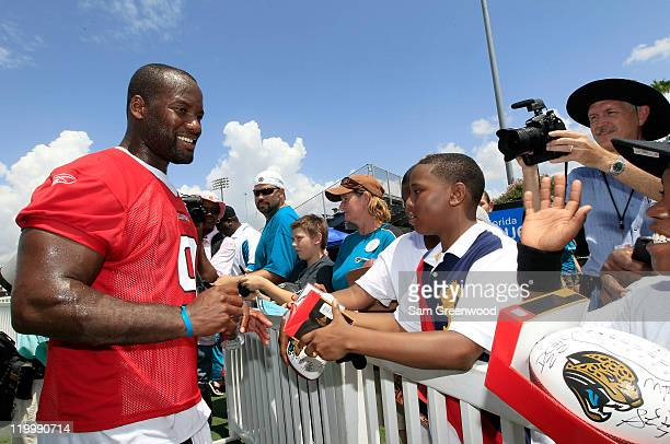 Quarterback David Garrard of the Jacksonville Jaguars signs autographs following training camp at Florida Blue Health and Wellness practice fields on...