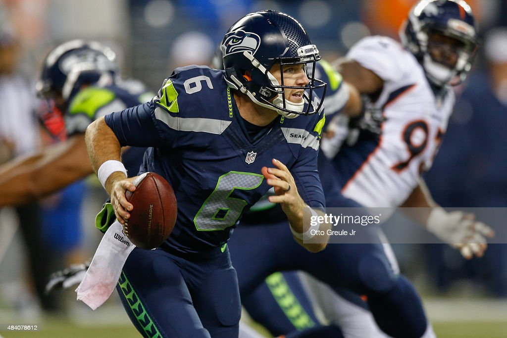 Quarterback David Gilreath #6 of the Seattle Seahawks looks to pass against the Denver Broncos at CenturyLink Field on August 14, 2015 in Seattle, Washington. The Broncos defeated the Seahawks 22-20.