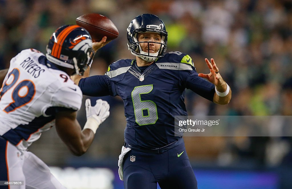 Quarterback David Gilreath #6 of the Seattle Seahawks passes against Gerald Rivers #99 of the Denver Broncos at CenturyLink Field on August 14, 2015 in Seattle, Washington.