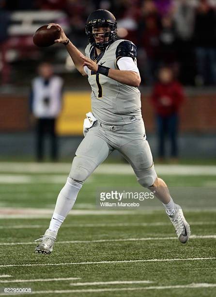 Quarterback Davis Webb of the California Golden Bears looks to pass against the Washington State Cougars in the second half at Martin Stadium on...