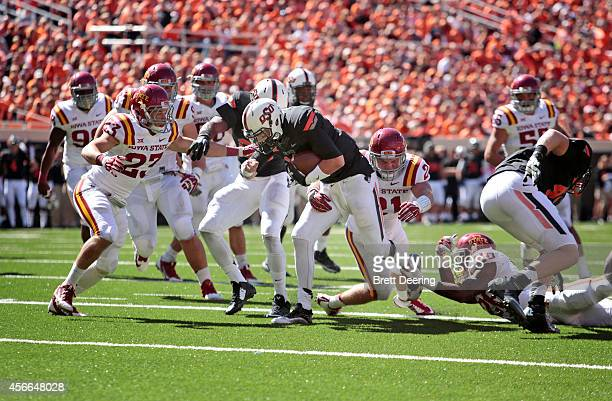 Quarterback Daxx Garman of the Oklahoma State Cowboys rushes upfield against the Iowa State Cyclones October 4 2014 at Boone Pickens Stadium in...