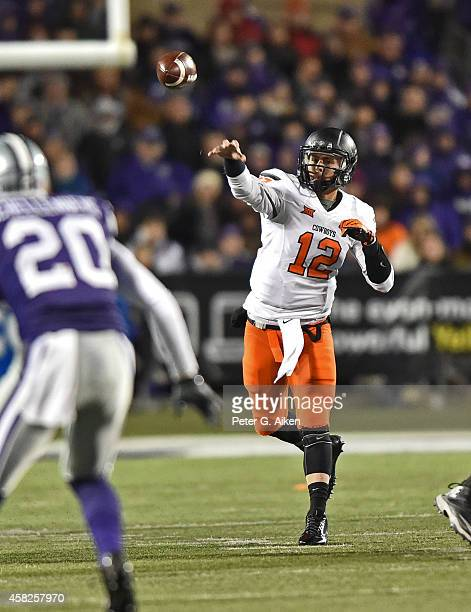 Quarterback Daxx Garman of the Oklahoma State Cowboys throws a pass down field against the Kansas State Wildcats during the second half on November 1...