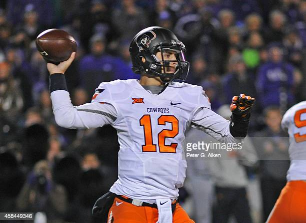 Quarterback Daxx Garman of the Oklahoma State Cowboys throws a pass against the Kansas State Wildcats during the first half on November 1 2014 at...