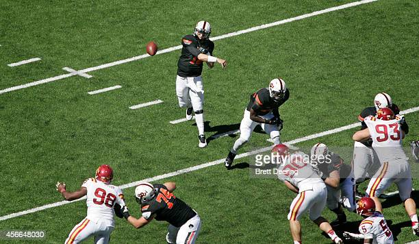 Quarterback Daxx Garman of the Oklahoma State Cowboys throws against the Iowa State Cyclones October 4 2014 at Boone Pickens Stadium in Stillwater...