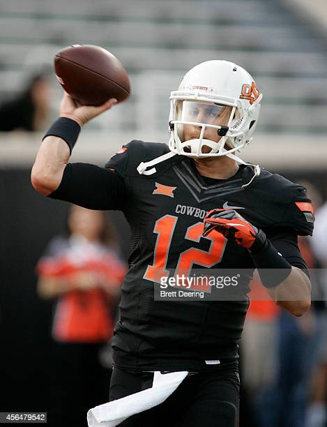 Quarterback Daxx Garman of the Oklahoma State Cowboys warms up before the game against the Texas Tech Red Raiders September 25 2014 at Boone Pickens...