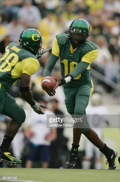 Quarterback Dennis Dixon of the Oregon Ducks looks to handoff against the Idaho Vandals to running back Andiel Brown during the game on September 25...
