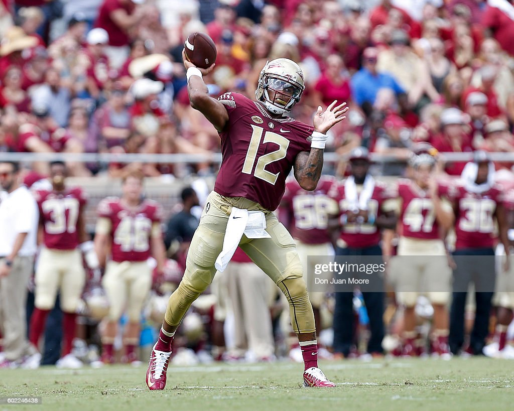 Quarterback Deondre Francois #12 of the Florida State Seminoles on a pass play during the game against the Charleston Southern Buccaneers at Doak Campbell Stadium on Bobby Bowden Field on September 10, 2016 in Tallahassee, Florida. The 3rd ranked Florida State defeated Charleston Southern 52 to 8.