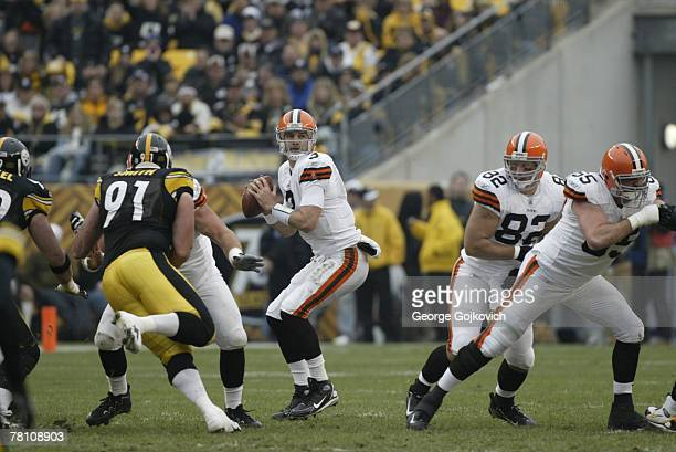 Quarterback Derek Anderson of the Cleveland Browns looks to pass as tight end Steve Heiden and offensive lineman Eric Steinbach block against the...