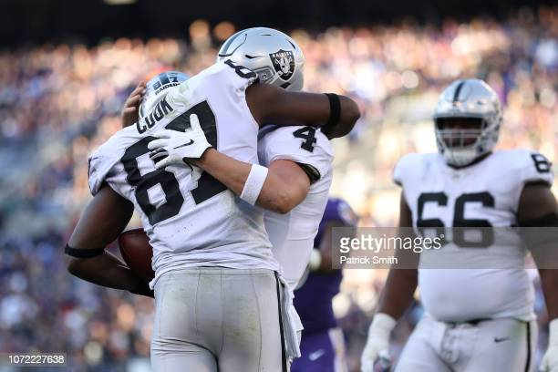 Quarterback Derek Carr and tight end Jared Cook of the Oakland Raiders celebrate after a touchdown in the third quarter against the Baltimore Ravens...